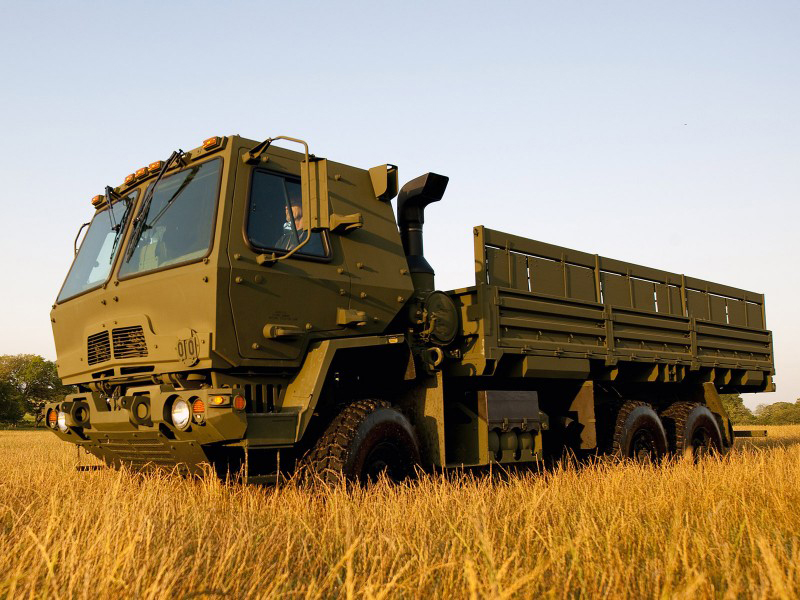 A FMTV 20-foot troop seat transport vehicle in a field of wheat. Jim Tenbusch is responsible for SWP's success over the last 30 years of selling custom wood products to residential customers and the US military.