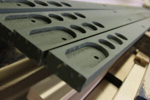 SWP's pultrusion process for composites starts with five or six shapes, but we have the capability to create many shapes to fit our customer's needs. Wooden sills in process of creation.