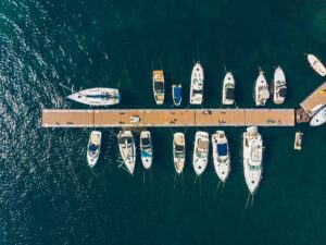 A bird's eye view of a composite boat dock with 15 kinds of various boats on the slip.